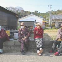 Elderly women gather for a chat on Gogo Island in Matsuyama, Ehime Prefecture, in March 2013. Japan has the world's highest proportion of elderly and the most centenarians, according to the World Health Organization. | BLOOMBERG