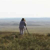 In a still taken from director Masako Sakata's latest film, 'Journey without End,' she is seen filming the Semipalatinsk nuclear test site in Kazakhstan in July 2013. | COURTESY OF SIGLO LTD/KYODO