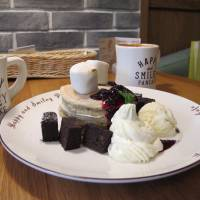 Pancakes topped with chocolate brownies and marshmallows are displayed at the Taipei branch of Kyushu Pancake Cafe on Monday.   KYODO