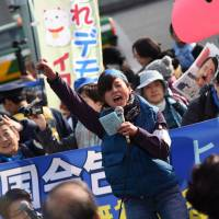 Protesters against the proposed transfer of U.S. Marine Corps Air Station Futenma to the Henoko coastal district of Okinawa Prefecture rally outside the Diet on Sunday. | FINBAR O'MALLON
