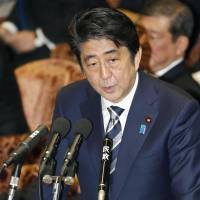 Prime Minister Shinzo Abe answers a lawmaker's question during a session of the Lower House Budget Committee on Thursday. | KYODO