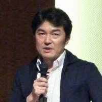 Yasuyuki Shimizu, a representative of Lifelink Suicide Prevention and Support Center, speaks at a symposium in Tokyo in September. | KYODO