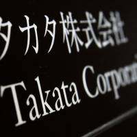 At least five deaths — four in the United States — have been linked to faults with air bag inflators manufactured by Takata Corp., headquartered at this building in Tokyo. | REUTERS