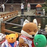 Stuffed toys are lined up for a photograph at Ryozenji Temple in Naruto, Tokushima Prefecture, as part of a toy tour offered to their elderly or disabled owners. | KYODO