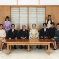 Emperor Akihito (front, third at left) and Empress Michiko (front, center) pose with their family during a photo session for the new year at the Imperial Palace in Tokyo on Nov. 18. Seen with them are Crown Princess Masako (front left), Crown Prince Naruhito (front, second left), Prince Akishino (front, third at right), Prince Hisahito (front, second at right), Princess Kiko (front right), Princess Aiko (back left) and Princess Kako (back right). | REUTERS