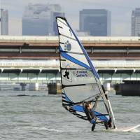 Windsurfers taking to Yodo River in downtown Osaka