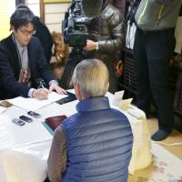 Shoichi Yukawa, father of hostage Haruna Yukawa, speaks to reporters at his home in Chiba Sunday. | KYODO
