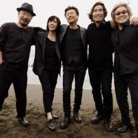 At issue: Southern All Stars singer Keisuke Kuwata (center) caused a stir when he made a political statement at the recent 'Kohaku Uta Gassen.' | KYODO