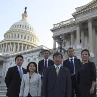 Island voice: New Diplomacy Initiative founder Sayo Saruta (front left) stands with Nago Mayor Susume Inamine (center) on the steps of the U.S. Congress in May 2014. Among other things, the think tank organizes trips for Okinawan politicians to Washington and visits to the island prefecture for U.S. decision makers. | NEW DIPLOMACY INITIATIVE