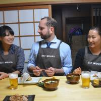 Bon appetit: Arisa Daggers (left) sits down with her students for a meal after an Eat Osaka class. | J.J. O'DONOGHUE