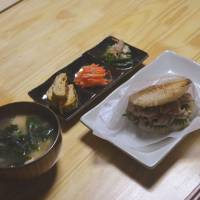 Simple and satisfying: Miso soup, tsukemono (pickled vegetables) and a rice burger are on the menu at Eat Osaka. | J.J. O'DONOGHUE