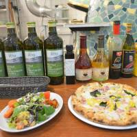 A little corny: A salad and pizza make great snacks at Mercato. | J.J. O'DONOGHUE