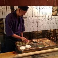An oden master at Otafuku serves up a familiar winter meal. | ROBBIE SWINNERTON