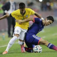 Japan looking to put troubles on back burner at Asian Cup