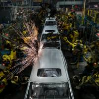 Sparks fly: Robots work on Odyssey minivans at Honda's production plant in Lincoln, Alabama, in August. | BLOOMBERG