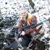 Tim Curnew poses with a deer he shot in Kumamoto Prefecture.   TONY ALDERMAN