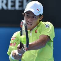 Trending up: Kei Nishikori hits a return against David Ferrer during the fourth round of the Australian Open on Monday. | AFP-JIJI