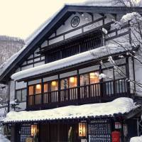 Cheerful welcome: The exterior of ryokan Honke Bankyu gives no indication that the inn was established in 1666. | MANDY BARTOK
