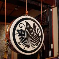 A hanging drum in the foyer bears the stylized butterfly crest of the Taira clan.  | MANDY BARTOK