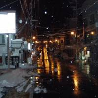 Ghost town: A light snow falls at night in the empty streets of Yuzawa. | DAN ASENLUND