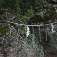 An ancient and sacred iwakura rock resting at Achi Shrine. | STEPHEN MANSFIELD