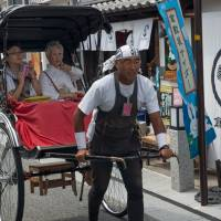 Reversing time: Taking a rickshaw is an atmospheric, albeit expensive way to see the old quarter. | STEPHEN MANSFIELD