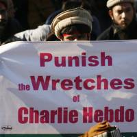 I'm not Charlie: A man in Pakistan holds a sign during a protest against satirical French weekly newspaper Charlie Hebdo. | REUTERS