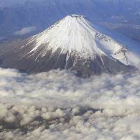 Not all that: 'We expected something bigger and more spectacular,' wrote one tourist about her trip to Mount Fuji. 'There was hardly any snow on it and it just wasn't pretty.' The visit was in August. Another called Fuji a 'brown hill.' | AP