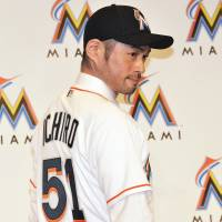Taking my talents to South Beach: Ichiro Suzuki shows off his new Miami Marlins jersey during his introductory news conference on Thursday. Ichiro is joining the National League club on a one-year deal worth $2 million. | YOSHIAKI MIURA