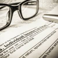 Feel the bureaucracy: U.S. tax filings just got more complicated for citizens living in Japan.   ISTOCK
