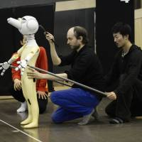 Poles position: Director/choreographer Sidi Larbi Cherkaoui (center) shows dancer Nobuhiro Shibuya (right) how to handle a puppet during rehearsals for the Belgian's 'Pluto' ahead of its upcoming Tokyo world premiere. | YOSHIE KOBAYASHI