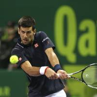 Djokovic whips Stakhovsky to make Qatar Open quarters