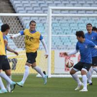 Game, set and match: South Korea's players train in Sydney on Sunday ahead of their Asian Cup semifinal against Iraq on Monday. | AFP-JIJI