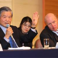 The task at hand: Former J. League chairman and task force chairman Saburo Kawabuchi (left) speaks as co-chairman Ingo Weiss listens during a news conference in Tokyo after the first meeting of task force on Wednesday. | KAZ NAGATSUKA