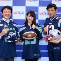 Coming to you live: From left: sports anchor Yuji Kondo, freelance announcer Rio Hirai and actor Tetsuya Bessho pose for pictures at a news conference at J-Wave on Wednesday. | J-WAVE