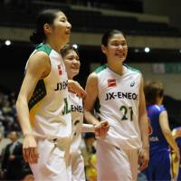 Emotional victory: JX-Eneos' Yuki Miyazawa (left), Asami Yoshida (center) and Yuka Mamiya look at the Sunflowers fans in the stands after the team clinched the All-Japan Championship. | KAZ NAGATSUKA