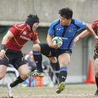 Wild ride: Panasonic's Shota Horie takes on the Toshiba defense during the Wild Knights' 50-15 LIXIL Cup semifinal win on Sunday.   KYODO