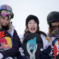 Girl's club: Winner Miyabi Onitsuka (center), silver medalist Anna Gasser (left) and third-placed Klaudia Medlova celebrate after the women's snowboard slopestyle Finals at the FIS Freestyle and Snowboarding World Ski Championships 2015 in Kreischberg, Austria on Wednesday. | AFP-JIJI