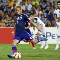 Honda penalty sparks Japan to victory over Iraq