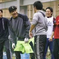 Ace OK: New York Yankees pitcher Masahiro Tanaka (second from left) laughs during a training session with members of the Eagles' pitching staff at Rakuten's indoor facility in Sendai on Thursday. | KYODO