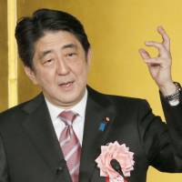 Prime Minister Shinzo Abe speaks to company executives and other guests at a New Year's gathering if business leaders in Tokyo on Jan. 6. | KYODO