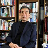 Kiyoshi Kurokawa, a professor at the National Graduate Institute for Policy Studies, talks to The Japan Times in his office in Tokyo on Dec. 30. | YOSHIAKI MIURA