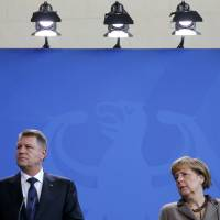 Romanian President Klaus Iohannis and German Chancellor Angela Merkel address a news conference at the Chancellery in Berlin on Thursday.  | REUTERS