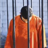 A man purported to be Islamic State captive Jordanian pilot Muath al-Kasaesbeh is seen standing in a cage in this still image from an undated video filmed from an undisclosed location made available on social media on Tuesday.   REUTERS