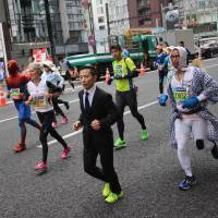 A collection of characters make their way through the streets of Ginza during the 2015 Tokyo Marathon on Feb. 22. | MARK THOMPSON