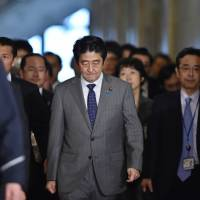 Prime Minister Shinzo Abe arrives at the Diet to attend a budget committee session of the House of Representatives on Jan. 30, the day after the deadline for a hostage sway involving journalist Kenji Goto had passed.  | AFP-JIJI