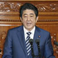 Speaking to the Lower House on Monday, Prime Minister Shinzo Abe said, 'I want to deepen public discussion about the way the Constitution should be, to match a new era. And based on such deepening of discussion, I will firmly and steadily work to revise the Constitution.' | KYODO