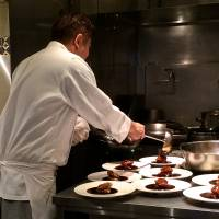 A chef adds finishing touches to outgoing plates of subuta. | ROBBIE SWINNERTON