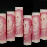 A portrait of late Chinese Communist Party Chairman Mao Zedong adorns 100-yuan notes. | REUTERS