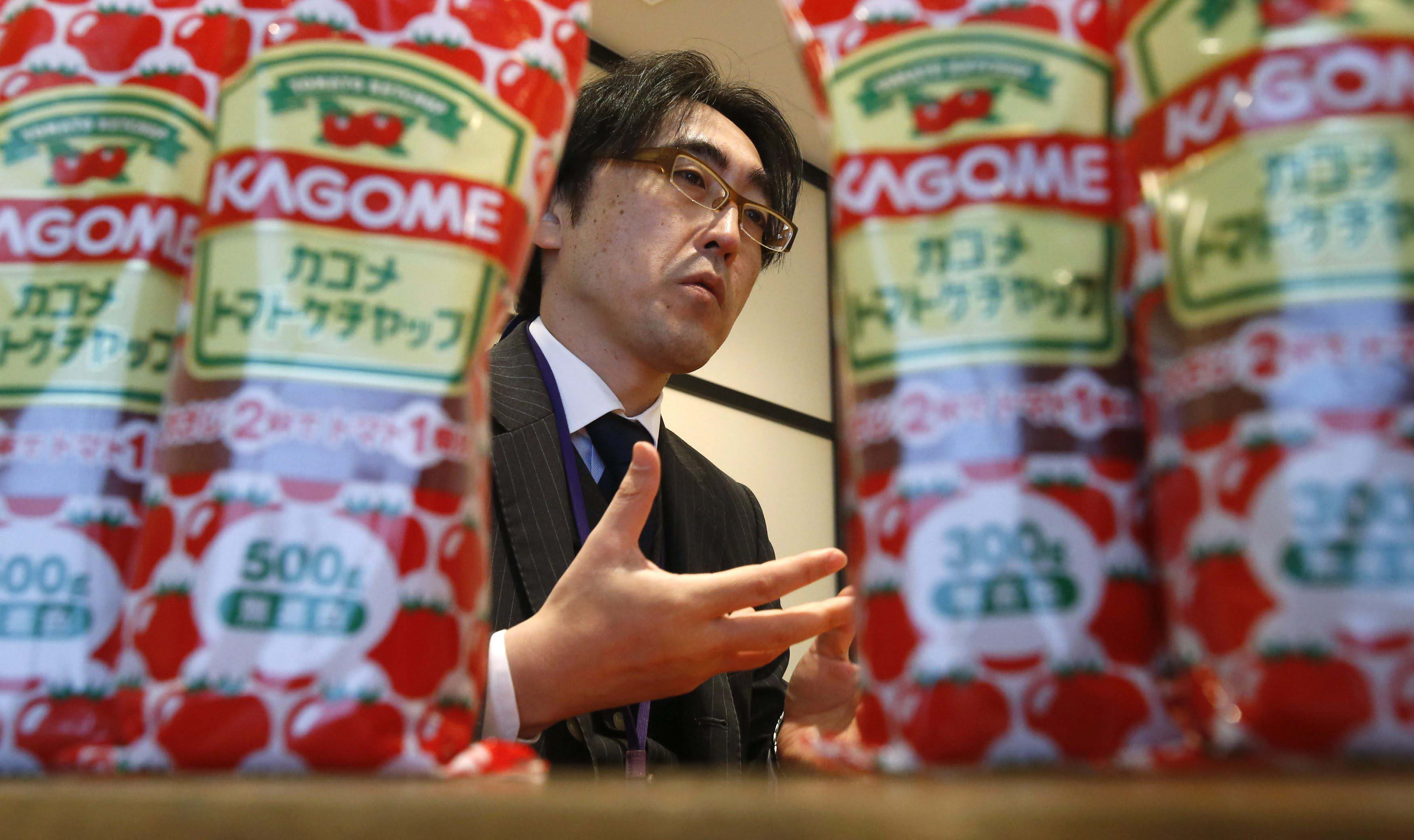 Fumitaka Ono, a manager in Kagome's product development department, speaks to a reporter at the firm's headquarters last month.   REUTERS